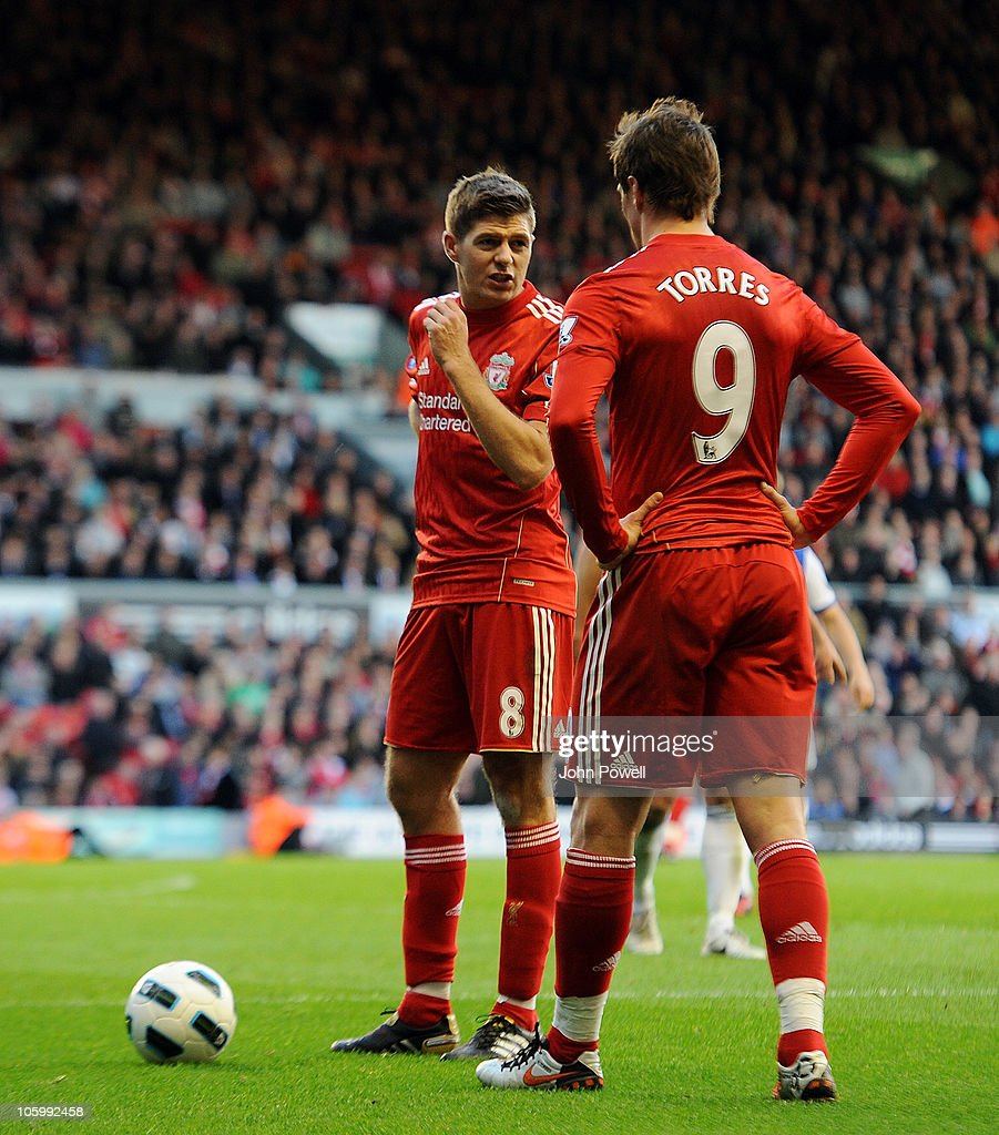 Steven Gerrard talks to Fernando Torres of Liverpool during the Barclays premier league match between Liverpool and Blackburn Rovers at Anfield on October 24, 2010 in Liverpool, England.