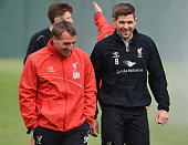 Steven Gerrard talks with Brendan Rodgers manager of Liverpool during a training session at Melwood Training Ground on May 14 2015 in Liverpool...