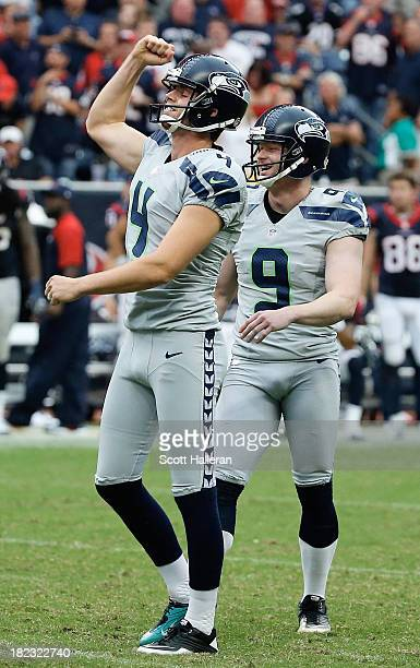 Steven Hauschka and Jon Ryan of the Seattle Seahawks celebrate after Hauschka hit a 45 yard field goal in overtime to defeat the Houston Texans 2320...