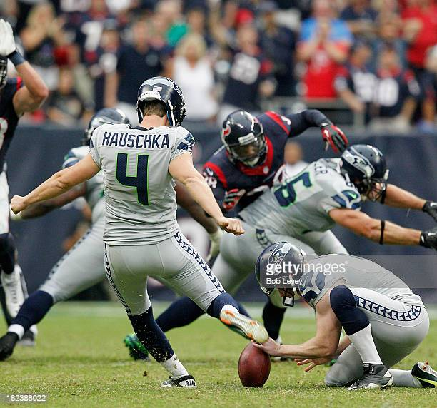 Steven Hauschka of the Seattle Seahawks kicks the winning field goal in overtime out of the hold of Jon Ryan of the Seattle Seahawks to beat the...