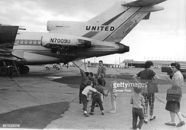 Steven Hawkins son of Mr and Mrs James Hawkins 2016 Holly St points eagerly to a Boeing 727 as Vernon Newbold escorts the children and trailing...