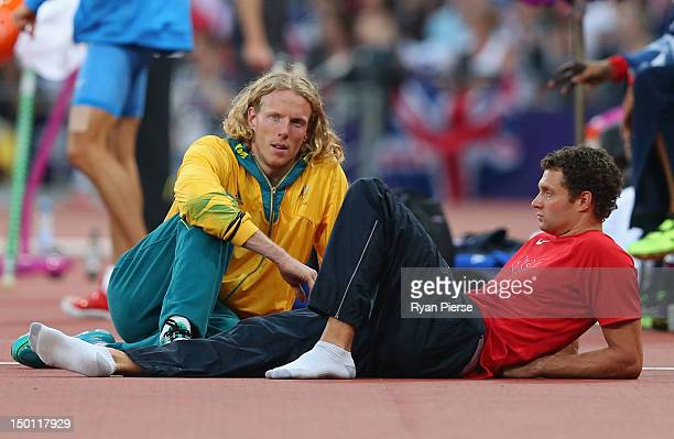 Steven Hooker of Australia talks to Brad Walker of the United States during the Men's Pole Vault Final on Day 14 of the London 2012 Olympic Games at...