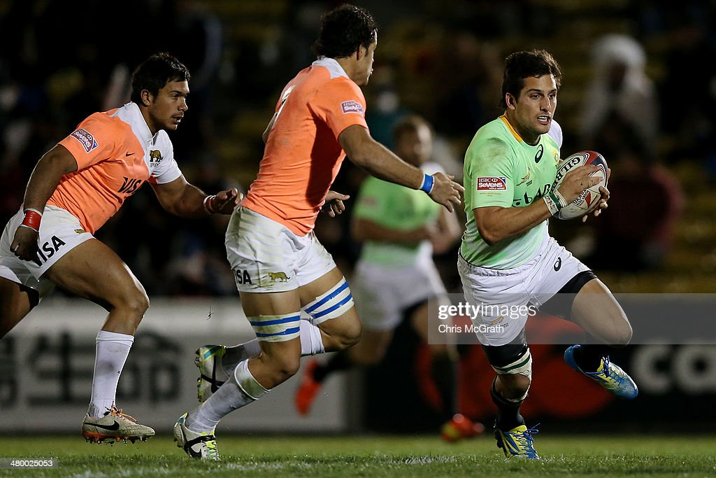 Steven Hunt #10 of South Africa makes a break against Argentina during the Tokyo Sevens, in the six round of the HSBC Sevens World Series at the Prince Chichibu Memorial Ground on March 22, 2014 in Tokyo, Japan.