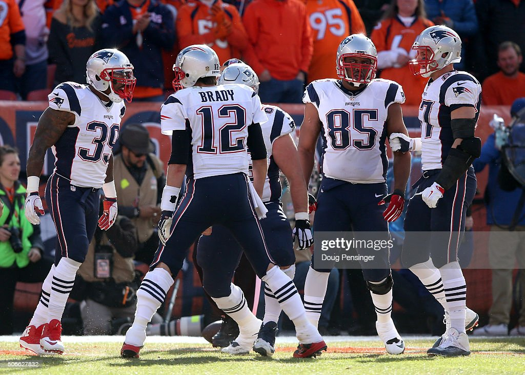 Steven Jackson and Tom Brady of the New England Patriots celebrate after a 1yard touchdown run by Jackson in the first quarter against the Denver...