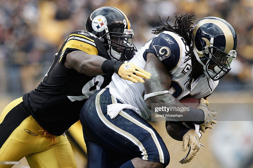 Steven Jackson #39 of St. Louis Rams runs with the ball while attempting to evade a tackle from Lawrence Timmons #94 of the Pittsburgh Steelers during the Christmas Eve game on December 24, 2011 at Heinz Field in Pittsburgh, Pennsylvania.