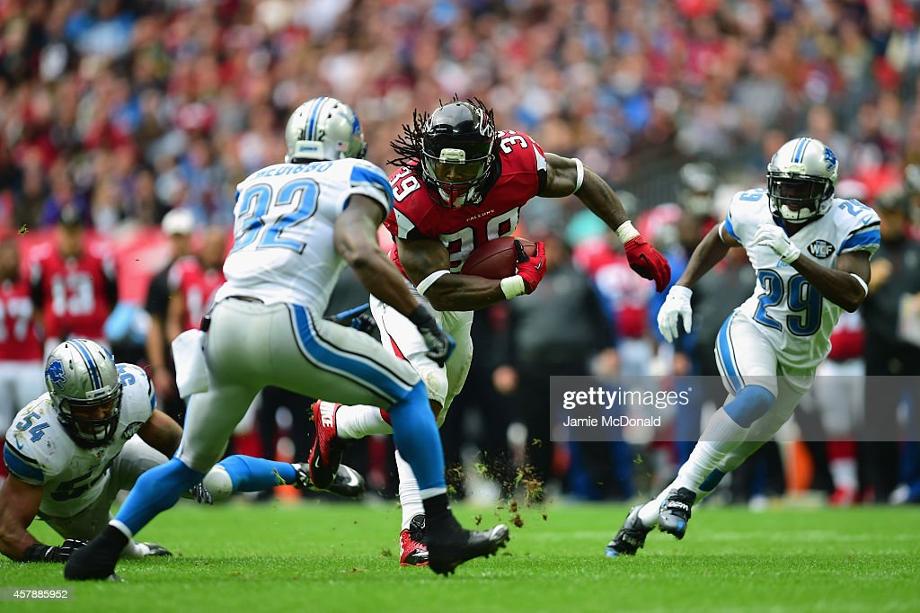 Steven Jackson of the Atlanta Falcons charges through the Lions defense during the NFL match between Detroit Lions and Atlanta Falcons at Wembley...