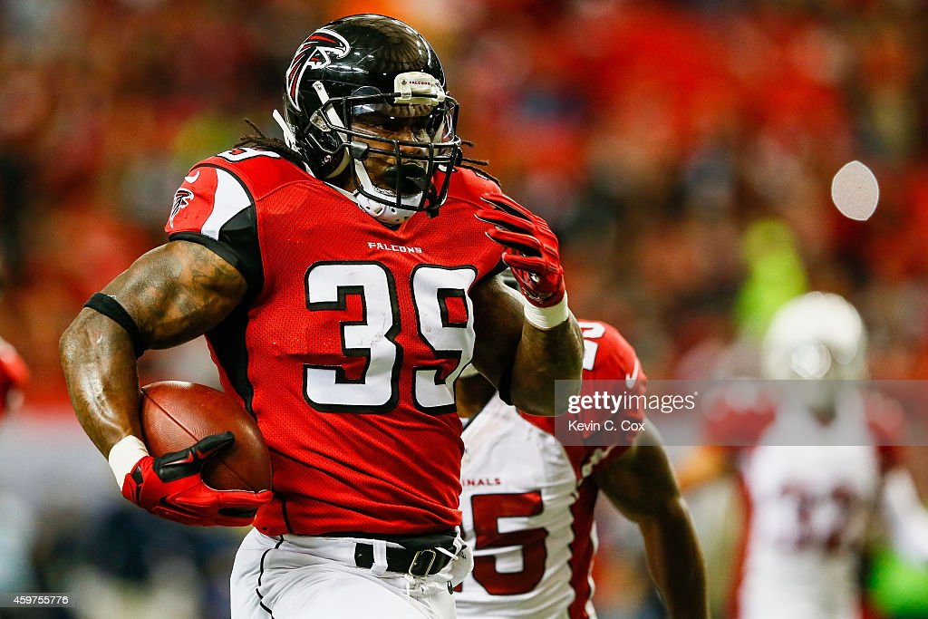 Steven Jackson of the Atlanta Falcons runs for a big gain during the first half against the Arizona Cardinals at the Georgia Dome on November 30 2014...