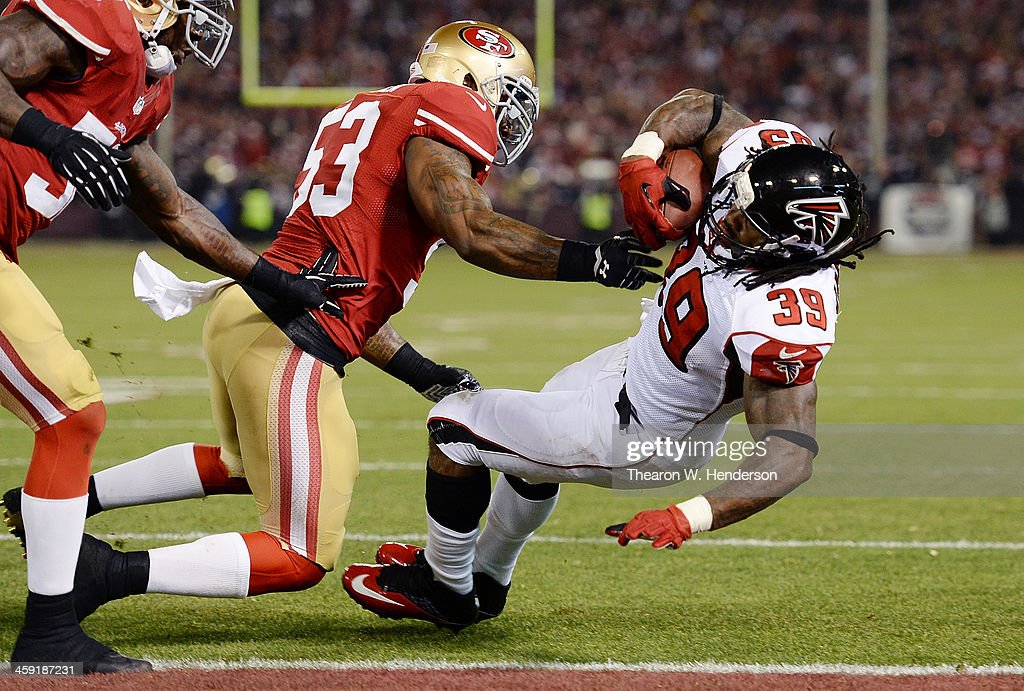 Steven Jackson of the Atlanta Falcons scored a touchdown on a twoyard run pushed into the endzone by NaVorro Bowman of the San Francisco 49ers during...