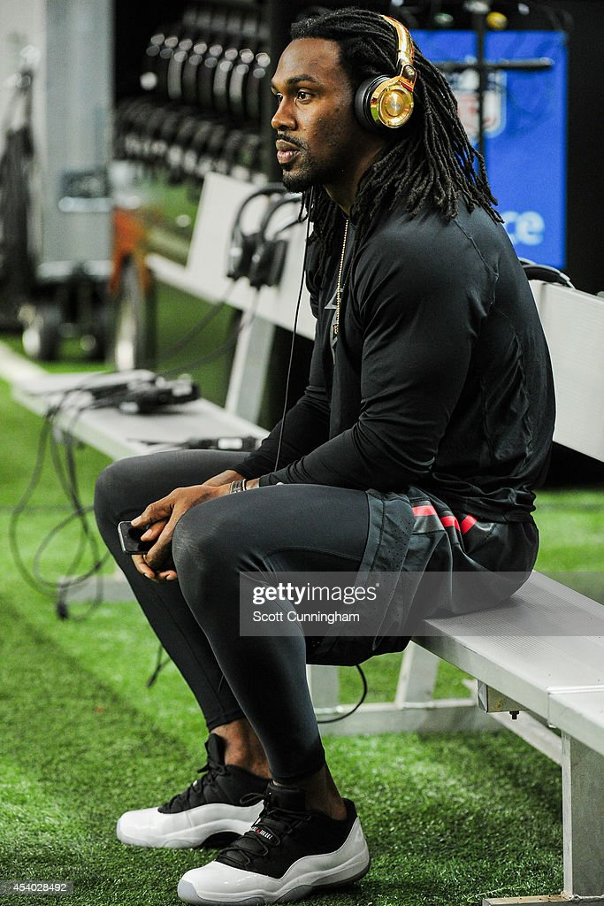 Steven Jackson of the Atlanta Falcons sits on the bench during warmups prior to a preseason game against the Tennessee Titans at the Georgia Dome on...