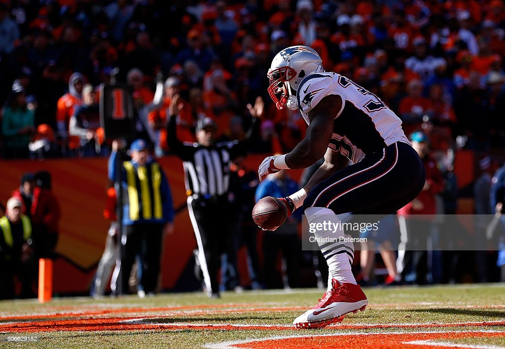 Steven Jackson of the New England Patriots celebrates after scoring a 1yard touchdown run in the first quarter against the Denver Broncos in the AFC...