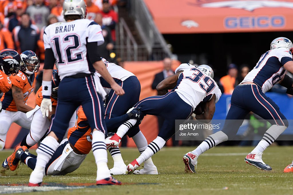 Steven Jackson of the New England Patriots is grabbed at the line of scrimmage for no gain in the second quarter The Denver Broncos played the New...