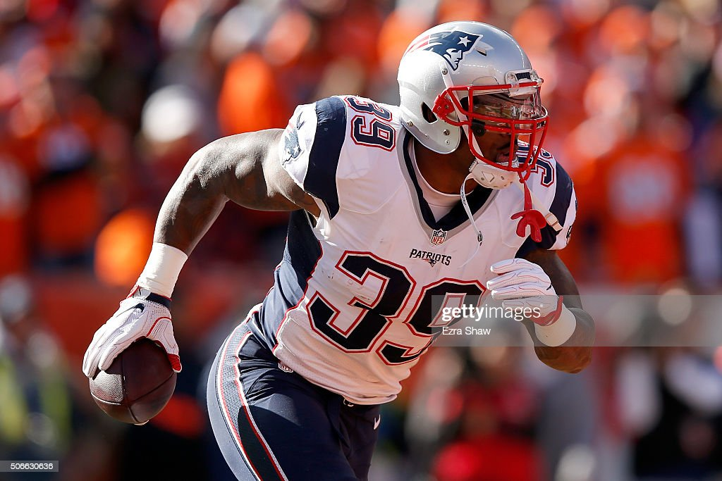 Steven Jackson of the New England Patriots runs with the ball in the first half against the Denver Broncos in the AFC Championship game at Sports...