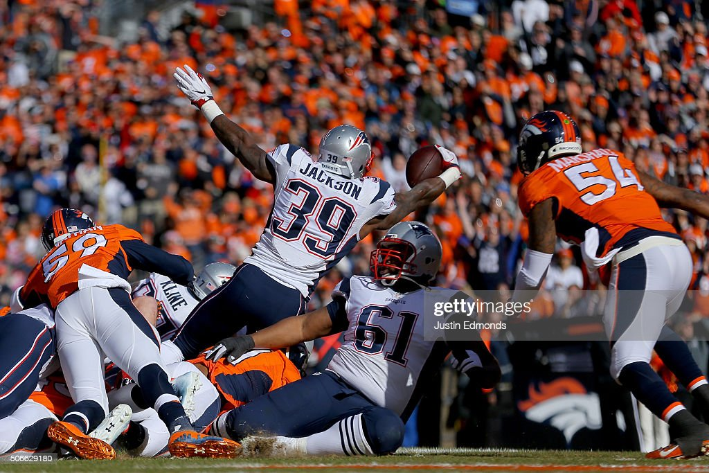 Steven Jackson of the New England Patriots rushes for a 1yard touchdown in the first quarter against the Denver Broncos in the AFC Championship game...
