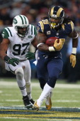 Steven Jackson of the St Louis Rams gets past Calvin Pace of the New York Jets at the Edward Jones Dome on November 18 2012 in St Louis Missouri