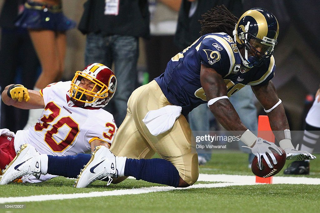 Steven Jackson of the St Louis Rams scores a touchdown against LaRon Landry of the Washington Redskins at the Edward Jones Dome on September 26 2010...