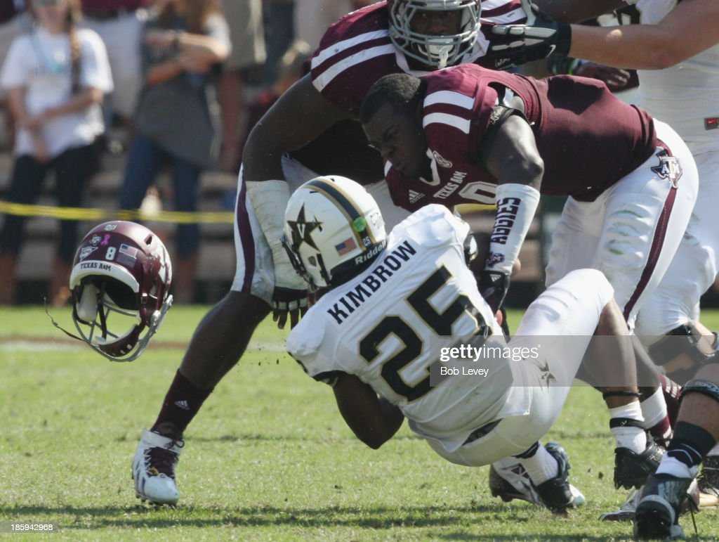 Steven Jenkins #8 of the Texas A&M Aggies loses his helmet as he tackles Brian Kimbrow #25 of the Vanderbilt Commodores in the second quarter at Kyle Field on October 26, 2013 in College Station, Texas.