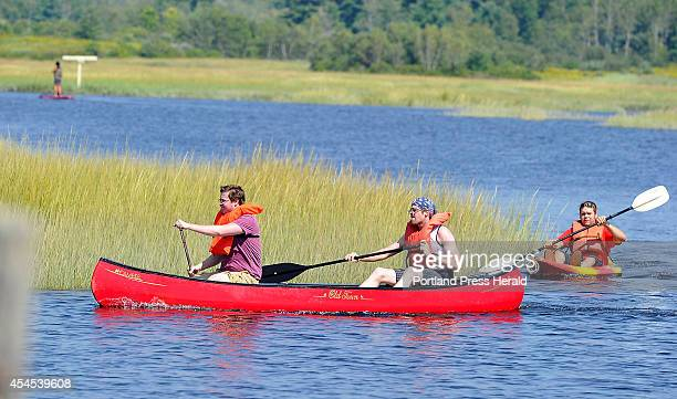 Steven Johnson left Dan McDonough and Robert Vonson all from Hoanesdale Pennsylvania enjoy canoeing and kayaking the marsh waterways at the...