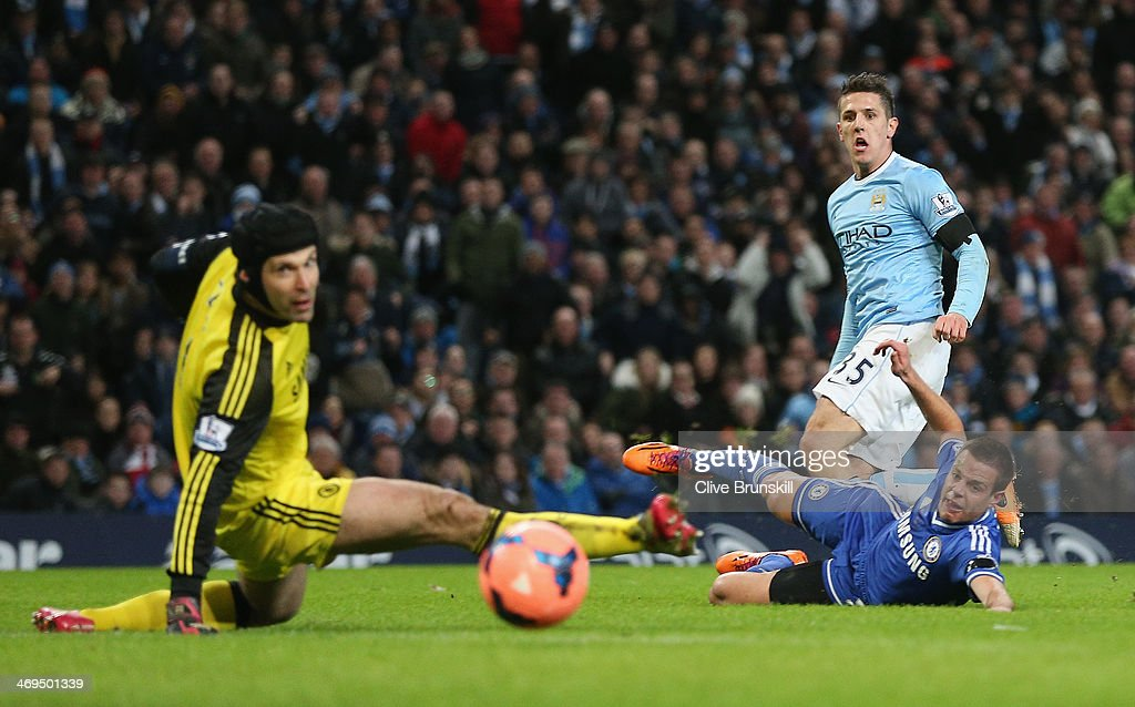 Steven Jovetic of Manchester City scores the first goal past <a gi-track='captionPersonalityLinkClicked' href=/galleries/search?phrase=Petr+Cech&family=editorial&specificpeople=212890 ng-click='$event.stopPropagation()'>Petr Cech</a> of Chelsea during the FA Cup Fifth Round match sponsored by Budweiser between Manchester City and Chelsea at Etihad Stadium on February 15, 2014 in Manchester, England.