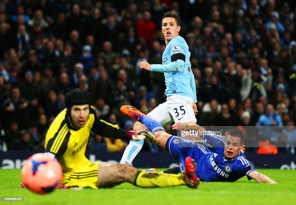 Steven Jovetic of Manchester City scores the first goal past Petr Cech of Chelsea during the FA Cup Fifth Round match sponsored by Budweiser between Manchester City and Chelsea at Etihad Stadium on February 15, 2014 in Manchester, England.