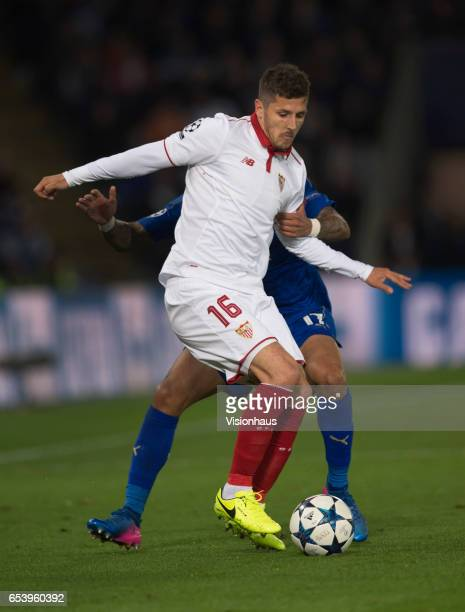 Steven Jovetic of Sevilla FC and Danny Simpson of Leicester City in action during the UEFA Champions League Round of 16 second leg match between...