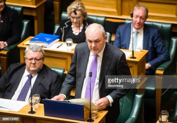 Steven Joyce New Zealand's finance minister bottom right delivers the budget in Parliament in Wellington New Zealand on Thursday May 25 2017 Joyce...