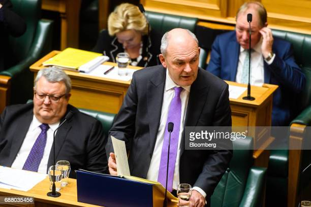 Steven Joyce New Zealand's finance minister bottom right delivers the budget at the parliament in Wellington New Zealand on Thursday May 25 2017...