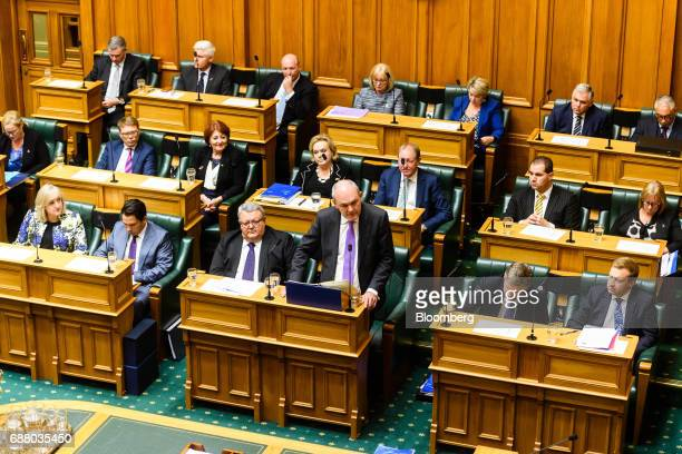 Steven Joyce New Zealand's finance minister bottom row center right delivers the budget at the parliament in Wellington New Zealand on Thursday May...