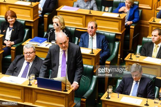 Steven Joyce New Zealand's finance minister bottom second left delivers the budget at the parliament in Wellington New Zealand on Thursday May 25...