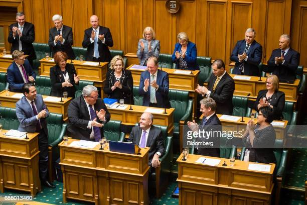 Steven Joyce New Zealand's finance minister center bottom receives a standing ovation after delivering the budget in Parliament in Wellington New...