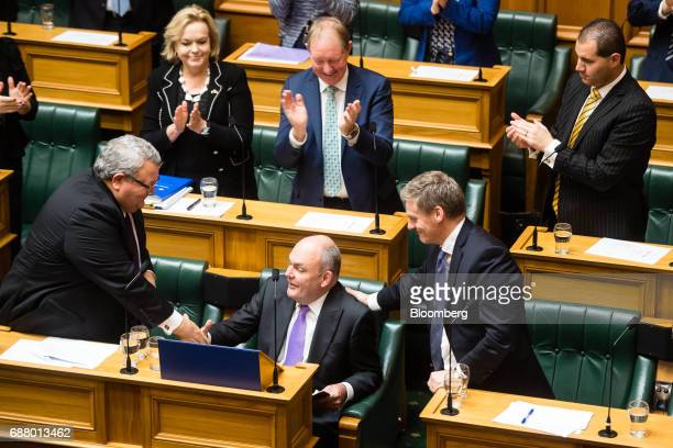Steven Joyce New Zealand's finance minister center bottom shakes hands with Gerry Brownlee foreign minister bottom left as Bill English prime...