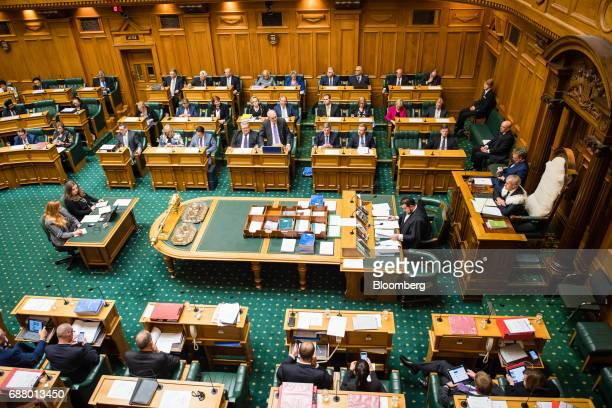 Steven Joyce New Zealand's finance minister third row from top center delivers the budget in Parliament in Wellington New Zealand on Thursday May 25...