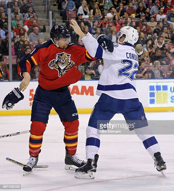 Steven Kampfer of the Florida Panthers and Erik Condra of the Tampa Bay Lightning fight during a game at BBT Center on November 16 2015 in Sunrise...
