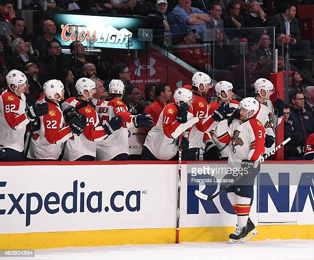 Steven Kampfer of the Florida Panthers celebrates with the bench after scoring a goal against the Montreal Canadiens in the NHL game at the Bell...