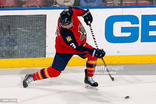 Steven Kampfer of the Florida Panthers shoots the puck against the New York Islanders at the BBT Center on March 7 2015 in Sunrise Florida