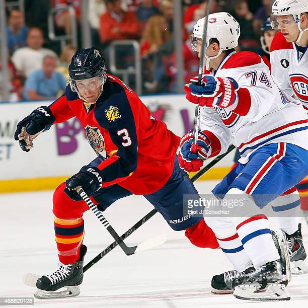 Steven Kampfer of the Florida Panthers skates for possession against Alexei Emelin of the Montreal Canadiens at the BBT Center on April 5 2015 in...