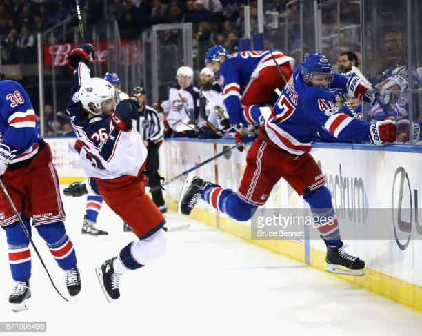 Steven Kampfer of the New York Rangers hits Zac Dalpe of the Columbus Blue Jackets during the third period at Madison Square Garden on November 6...