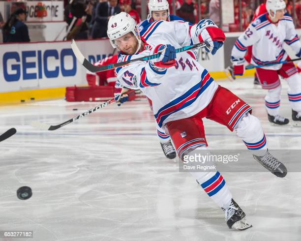 Steven Kampfer of the New York Rangers shoots the puck in warm ups before an NHL game against the Detroit Red Wings at Joe Louis Arena on March 12...