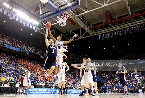 Steven Kaspar of the Bucknell Bison shoots against Kameron Woods of the Butler Bulldogs in the first half during the second round of the 2013 NCAA...