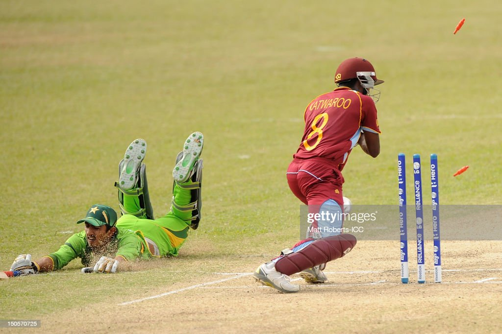 Steven Katwaroo of the West Indies knocks the bails off to runout Syed Faraz Ali of Pakistan during the ICC U19 Cricket World Cup 2012 Semi Final match between Pakistan and the West Indies at Endeavour Park on August 22, 2012 in Townsville, Australia.