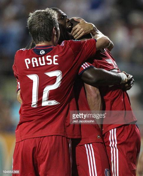 Steven Kinney of the Chicago Fire celebrates with Logan Pause and Kwame WatsonSirioe after scoring against the San Jose Earthquakes during an MLS...