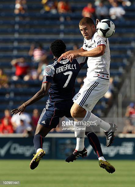 Steven Kinney of the Chicago Fire heads the ball away from Kenny Mansally of the New England Revolution during a SuperLiga 2010 match at Toyota Park...