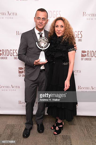 Steven Kolb and designer Reem Acra attend Bridges Of Understanding's annual 'Building Bridges' award dinner honoring designer Reem Acra with Steven...