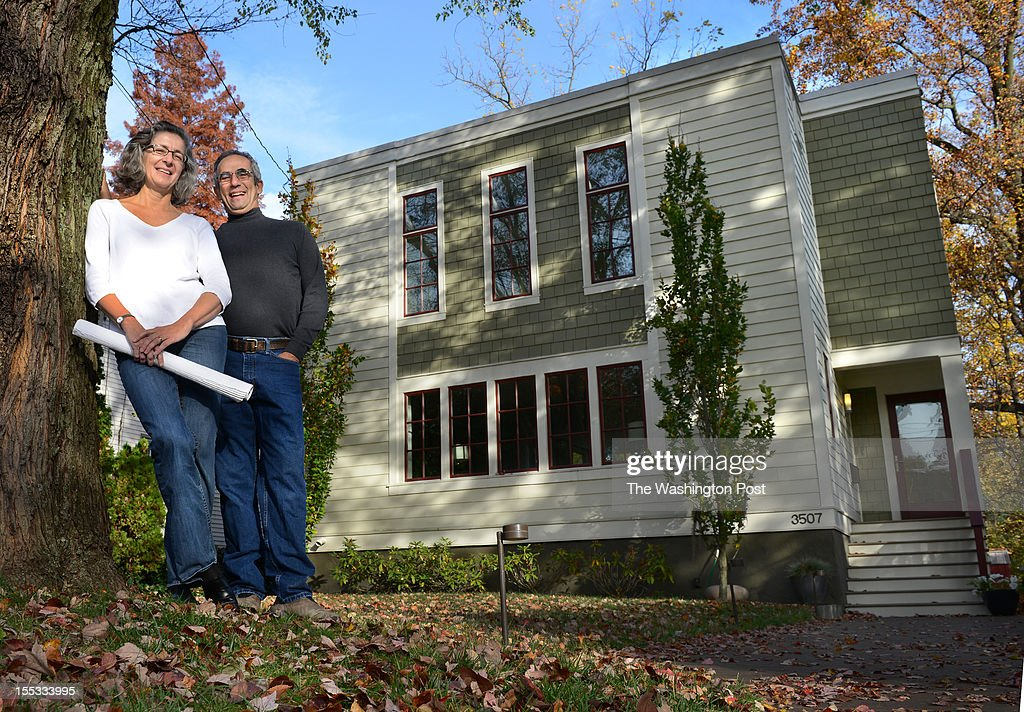 Steven Lann and Larysa Kurylas tore down their old house and built this two-story contemporary in Kensington, MD on October 27, 2012. Larysa is an architect and designed the home. Steve made the cherry cabinets in the living room.