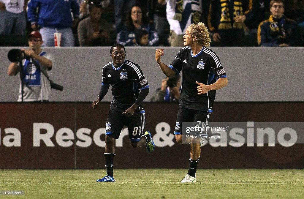 Steven Lenhart #24 of the San Jose Earthquakes celebrates his goal with teammate Marvin Chavez #81 in the second half of the MLS match against the Los Angeles Galaxy at The Home Depot Center on May 23, 2012 in Carson, California. The Earthquakes defeated the Galaxy 3-2.