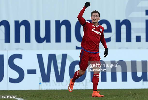Steven Lewerenz of Kiel jubilates after scoring the second goal during the third league match between FC Hansa Rostock and Holstein Kiel at...