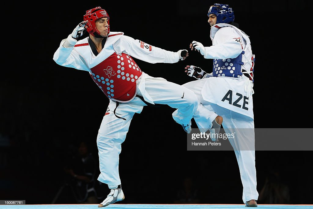 Steven Lopez of The United States of America competes against Ramin Azizov of Azerbaijan during the Men's 80kg Taekwondo Preliminary Round on Day 14...
