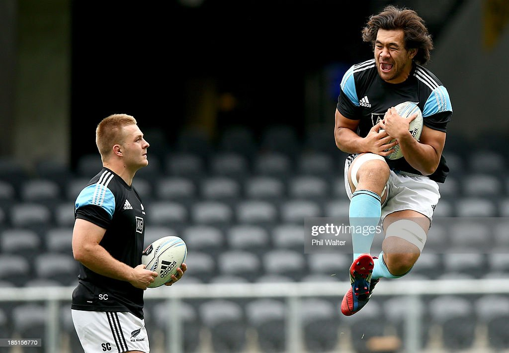 Steven Luatua and Sam Cane practice their catching skills during the New Zealand All Blacks captain's run at Forsyth Barr Stadium on October 18 2013...