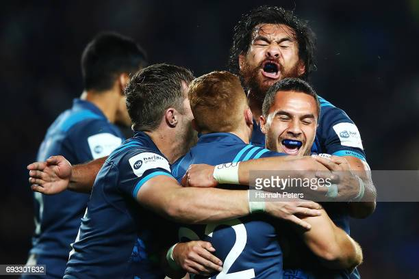Steven Luatua Ihaia West Matt Duffie and Sam Nock of the Blues celebrate after winning the match between the Auckland Blues and the British Irish...