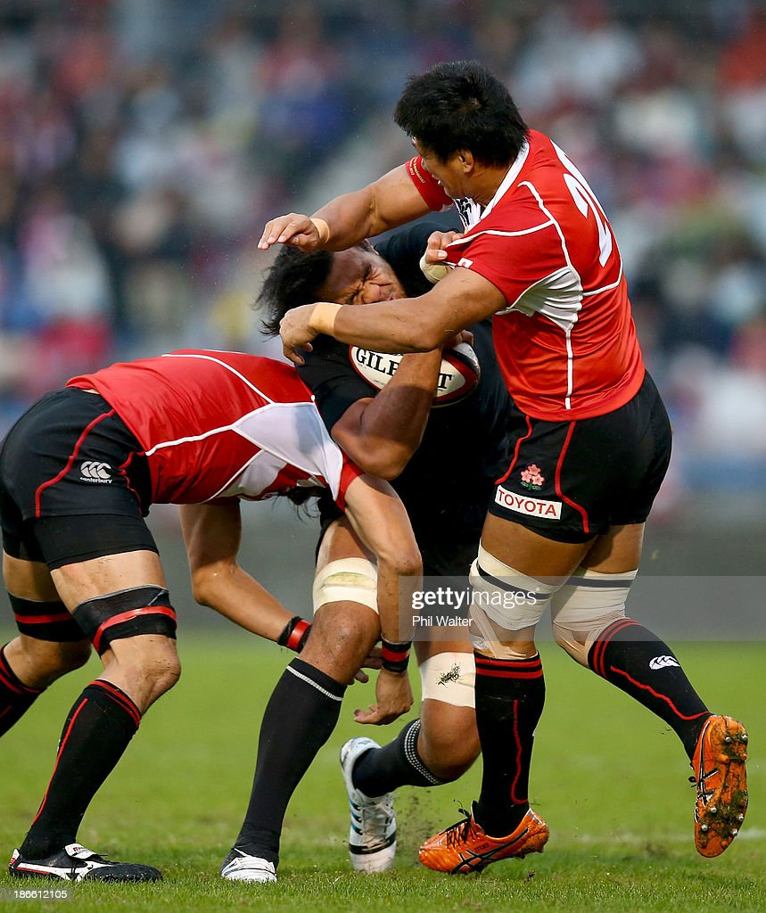 <a gi-track='captionPersonalityLinkClicked' href=/galleries/search?phrase=Steven+Luatua&family=editorial&specificpeople=6164979 ng-click='$event.stopPropagation()'>Steven Luatua</a> of the All Blacks is tackled by <a gi-track='captionPersonalityLinkClicked' href=/galleries/search?phrase=Takashi+Kikutani&family=editorial&specificpeople=563879 ng-click='$event.stopPropagation()'>Takashi Kikutani</a> of Japan during the International Rugby Test Match between Japan and the New Zealand All Blacks at Prince Chichibu Memorial Rugby Stadium on November 2, 2013 in Tokyo, Japan.