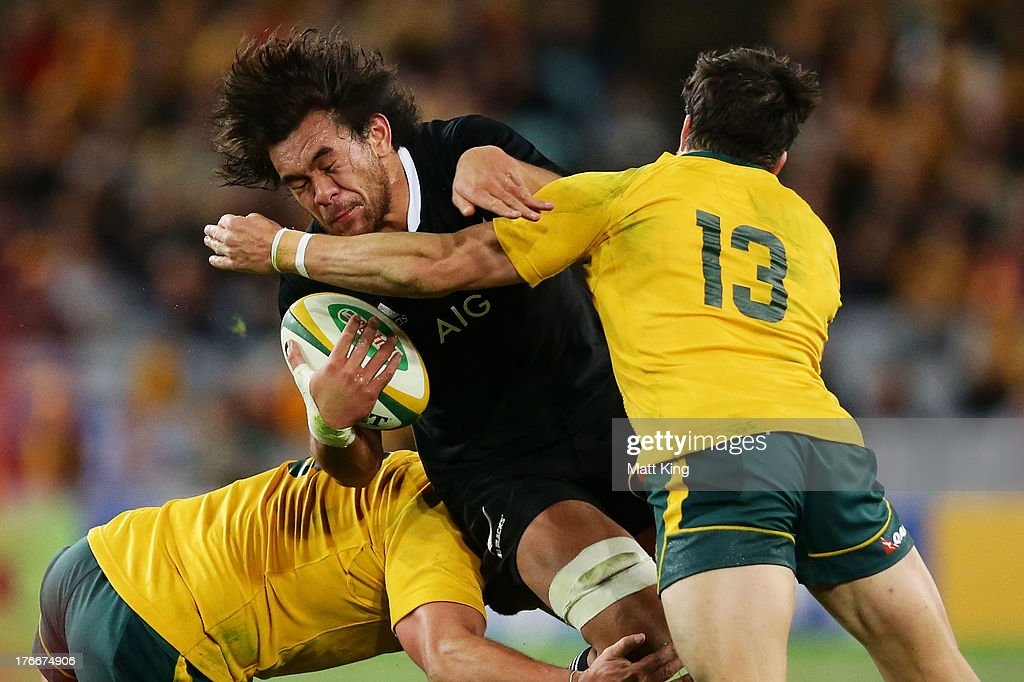 Steven Luatua of the All Blacks is tackled during The Rugby Championship Bledisloe Cup match between the Australian Wallabies and the New Zealand All Blacks at ANZ Stadium on August 17, 2013 in Sydney, Australia.